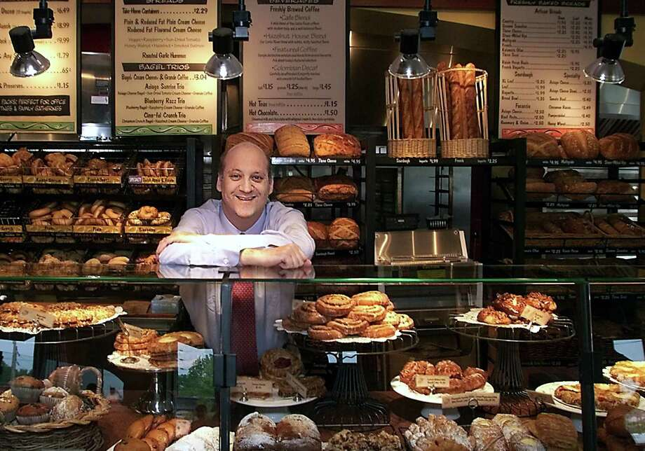 FILE - In this May 2002 file photo, Panera Bread Co. CEO Ron Shaich stands behind a counter at a location in St. Louis. Shaich, who recently sold the cafe chain he founded for $7.2 billion, says that a Wall Street culture relentlessly focused on short-term profit and quarterly metrics is stifling innovation. Photo: Tom Gannam /Associated Press / Copyright 2017 The Associated Press. All rights reserved.