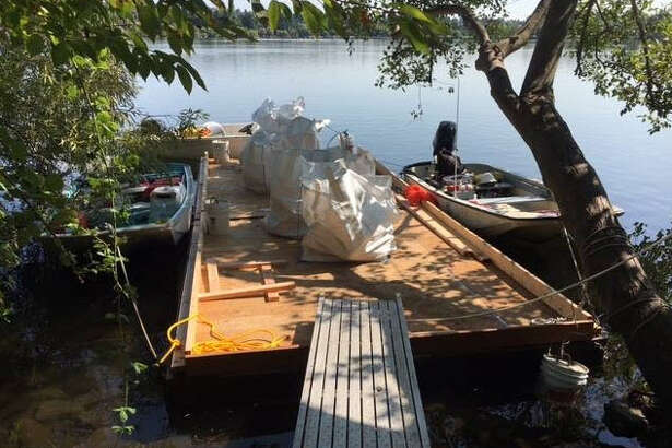 Seattle parks crews started cleaning up an illegal skate park on Green Lake's Duck Island on Tuesday.