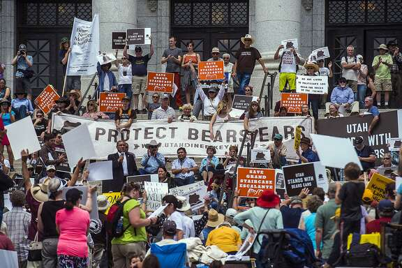 FILE - In this May 6, 2017 file photo, hundreds of people gather during the Monumental Rally for Bears Ears and Grand Staircase Monuments at the Utah State Capitol, in Salt Lake City. Conservation groups are airing TV ads, planning rallies and creating parody websites in a last-minute blitz to persuade Interior Secretary Ryan Zinke to refrain from reducing or eliminating large swaths of land across the country that have been designated as national monuments, Tuesday, Aug. 22, 2017. (Chris Detrick/The Salt Lake Tribune via AP, File)