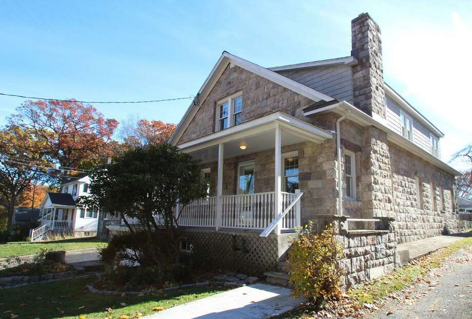 The exterior of the modest colonial farmhouse at 88 Hecker Ave. is composed of hand-cut stone. Photo: /