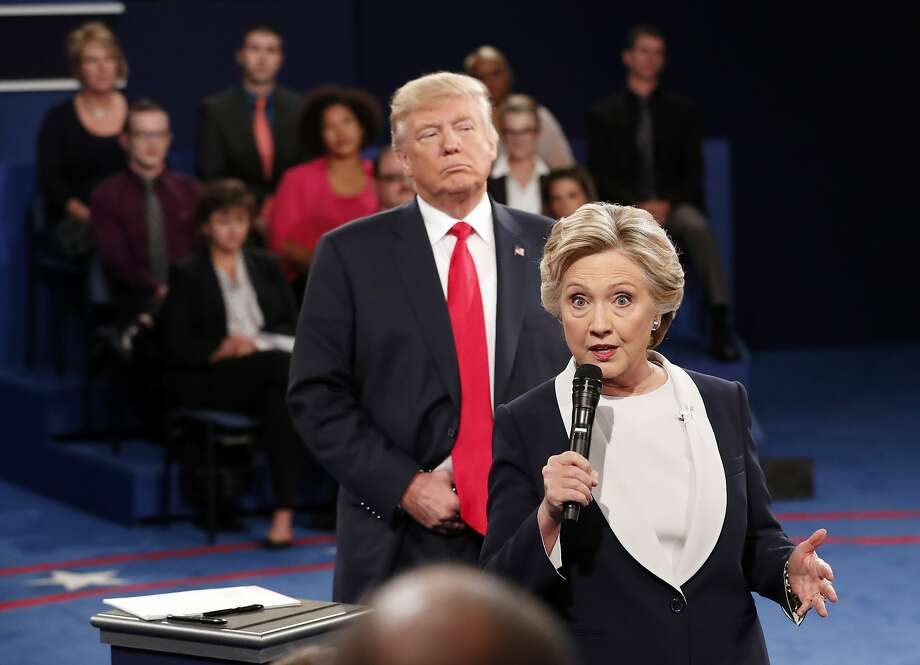 Donald Trump hovers around Hillary Clinton during their October debate. Photo: Rick T. Wilking, Associated Press