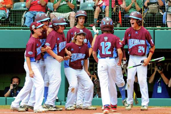 Fairfield American teammates greet Troy Ashkinos (12) at home plate after he hit a grand slam home run during Little League World Series action against Jackson, NJ at Lamade Stadium in South Williamsport, Penn., on Wednesday Aug. 23, 2017.