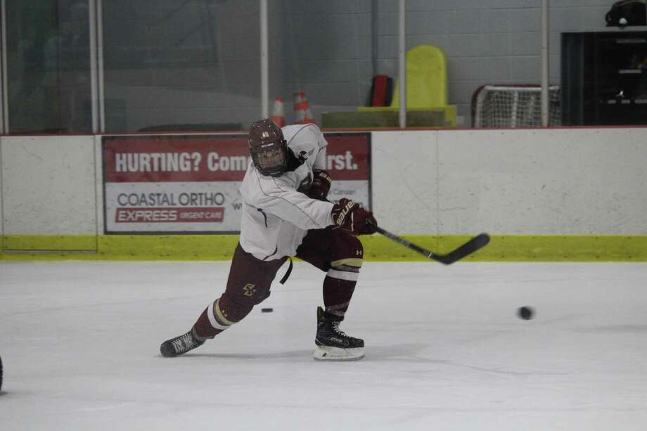 Boston College rising junior Christopher Brown fires a puck during a training session with Chris Gragnano at the Darien Ice Rink. Photo: Anthony E. Parelli / Hearst Connecticut Media / Darien News