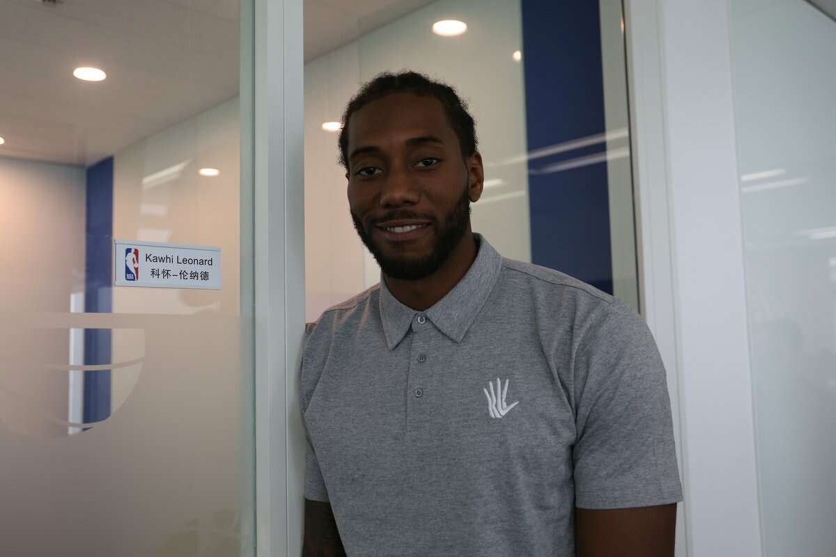 Kawhi the office man As part of his shadowing schedule with China CEO David Shoemaker, Kawhi Leonard attended business meetings with China executives and conducted a chalk talk with NBA staff.