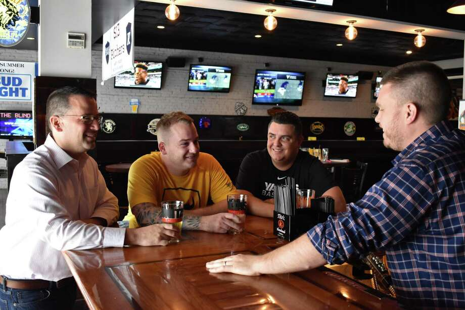 PJ Kennedy, Thomas Burns, Ilario Altamura and Casey Dohme (L-R) at Dohme's Blind Rhino tavern in Norwalk, Conn. The four are planning the Hey Stamford Food Festival scheduled for Saturday, Aug. 26, 2017, at Mill River Park in Stamford, Conn. Photo: Alexander Soule / Hearst Connecticut Media / Stamford Advocate