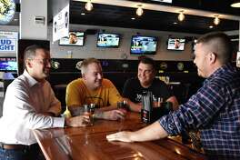 PJ Kennedy, Thomas Burns, Ilario Altamura and Casey Dohme (L-R) at Dohme's Blind Rhino tavern in Norwalk, Conn. The four are planning the Hey Stamford Food Festival scheduled for Saturday, Aug. 26, 2017, at Mill River Park in Stamford, Conn.