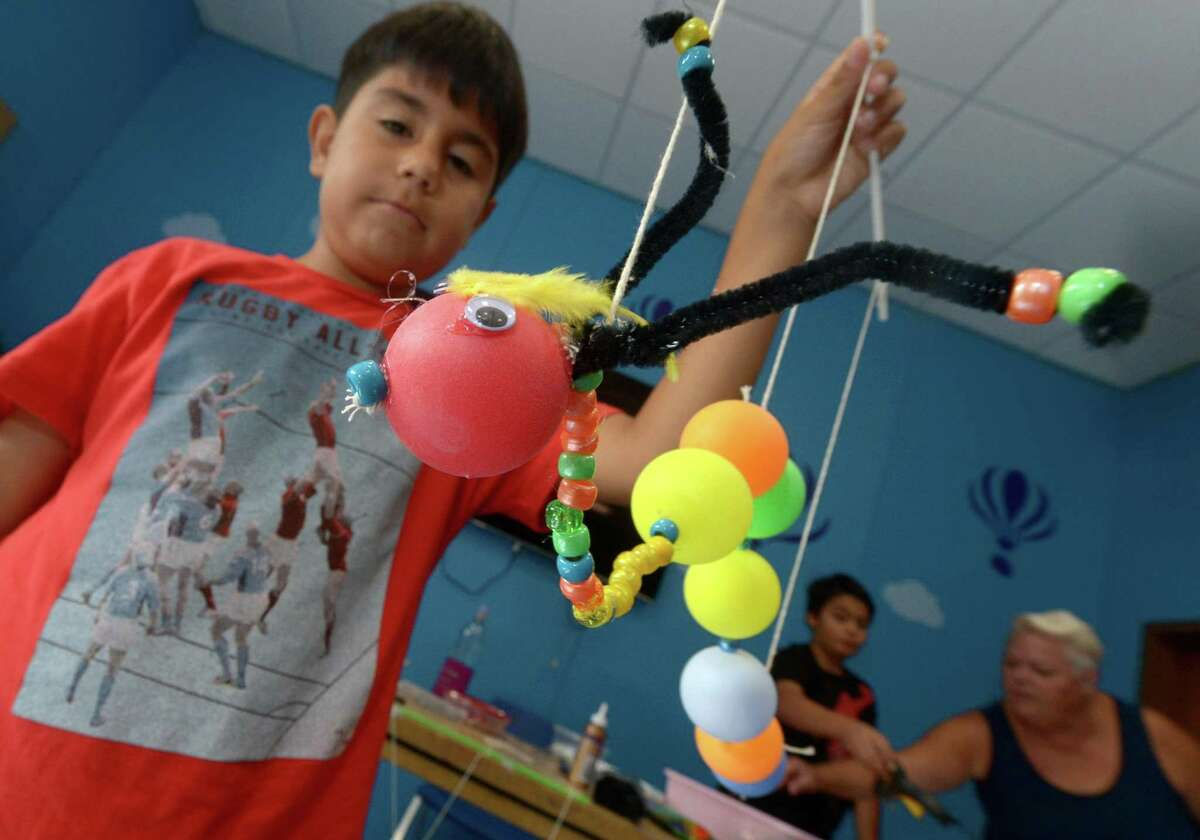 Luis Palomeque, 10, makes caterpillar mariontette during a five-day puppet workshop at the Norwalk Public Library main branch on Belden Avenue Thursday, Aug. 17.