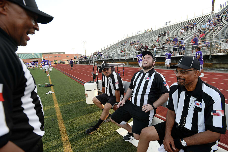 Eighteen-year veteran referee Ronnie Shilo jokes with (from left) Joe Flores, Ryan Moran, and Robert Spain as he reviews procedures and foul calls with his four-man crew (including Chad Lemoine) as they await the start of Friday's scrimmage between West Orange - Stark and Port Neches - Groves at Port Neches. Area teams will have enough referees to work games throughout this season, but just barely as the numbers have dwindled. A combination of low pay and long hours, coupled with a decline in younger generations advancing to replace retiring refs   has led to the shortage.  Photo taken Friday, August 18, 2017 Kim Brent/The Enterprise Photo: Kim Brent / BEN