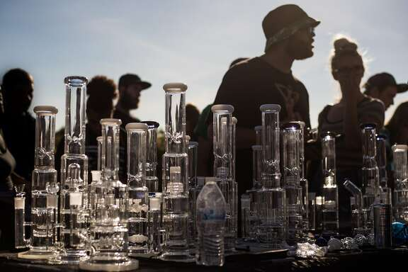 Festival goers shop for 50% off bongs during Hempfest at Myrtle Edwards Park on Sunday, Aug. 20, 2017. (GRANT HINDSLEY, seattlepi.com)