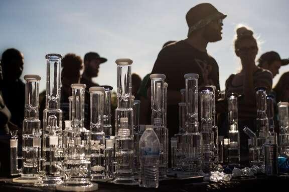 Festival goers shop for 50% off bongs during Hempfest at Myrtle Edwards Park on Sunday, Aug. 20, 2017. (GRANT HINDSLEY, seattlepi.com)
