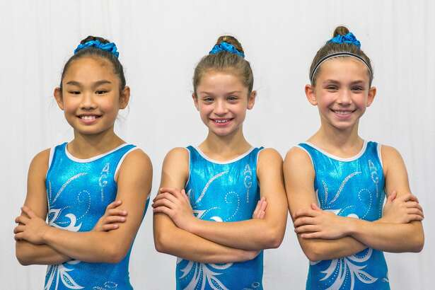 Gymnasts competing for Artistic Gymnastics Institute at the U.S. National Training Center are, from left to right, Maya Taylor, Lilly Trettenero and Reese Hampton.