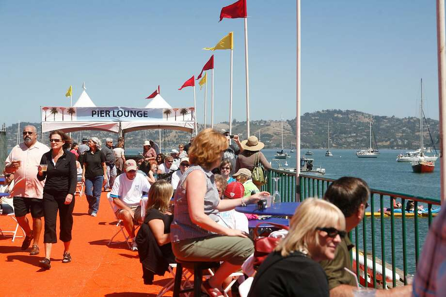 Patrons sit along the Pier Lounge in the Sausalito Art Festival. Photo: Jasna Hodzic, The Chronicle