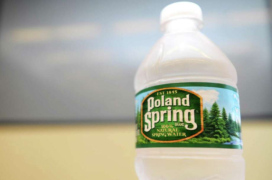 A Poland Spring water bottle is displayed in Nestlé Waters North America's headquarters at 900 Long Ridge Road, in Stamford, Conn. Photo: Michael Cummo / Hearst Connecticut Media / Stamford Advocate