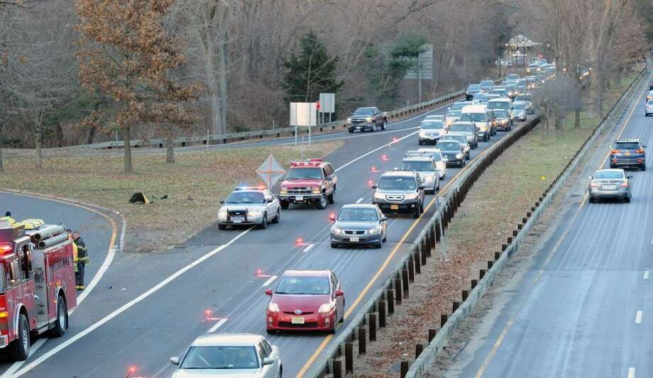 The scene of a rollover of one vehicle in the southbound lane near exit 27 of the Merritt Parkway in Greenwich, Conn., Friday afternoon, Jan. 2, 2015. Greenwich Fire Department officials on the scene said two people were injured in the accident and taken to the hospital. Photo: Bob Luckey / Bob Luckey / Greenwich Time