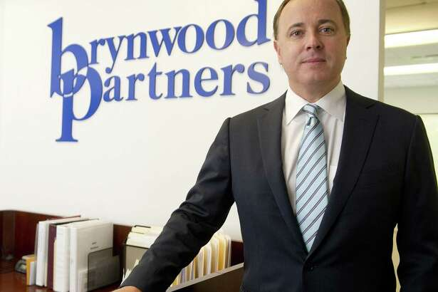 Henk Hartong, Chairman and Chief Executive Officer of Brynwood Partners, poses for a photo in the company's Greenwich office on Thursday, August 21, 2014.