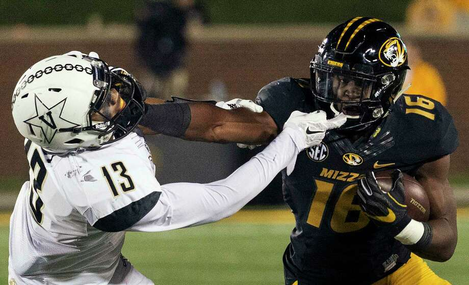 File-This Nov. 12, 2016, file photo shows Missouri running back Damarea Crockett, right, stiff-arming Vanderbilt's LaDarius Wiley, left, during the fourth quarter of an NCAA college football game in Columbia, Mo. Good players can get lost on bad teams, but here are a few who will be worth seeking out in 2017. Just don't wait until bowl season because it will probably be too late. (AP Photo/L.G. Patterson, File) Photo: L.G. Patterson, FRE / FR23535 AP