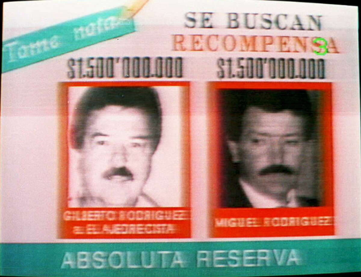 """Gilberto Rodriguez Orejuela (left) and Miguel Angel Rodriguez Orejuela (right) - Season 3 Season 3 of """"Narcos"""" focuses on the leaders of the Cali Cartel, Gilberto Rodriguez Orejuela and Miguel Angel Rodriguez Orejuela. This photo shows an advertisement that offers rewards for $1.5 million for information leading to the capture of the men."""