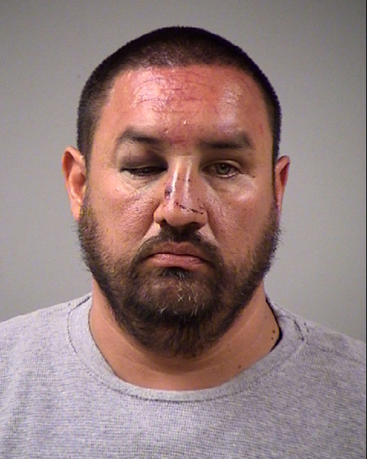 Mike Flores Jr. seen in a mugshot after a state arrest in 2013. Court records show Flores was arrested Aug. 3 after he allegedly bought a kilogram of cocaine from Pedro Requejo Gutierrez, 68, and crashed while fleeing from agents.