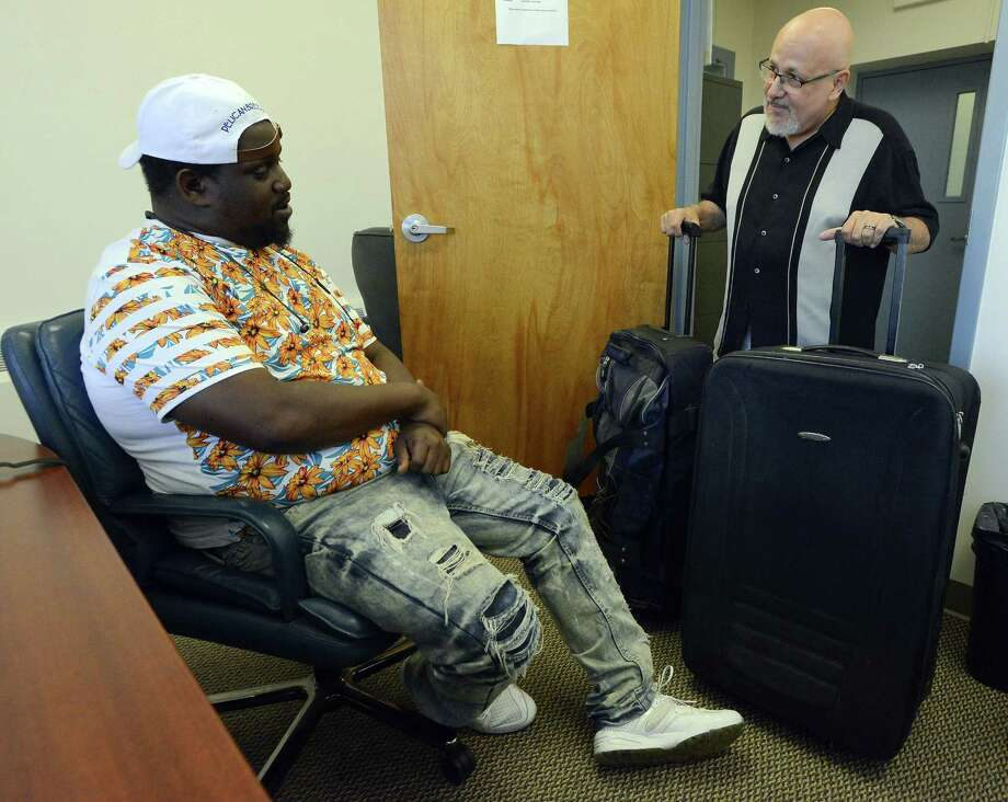 Rafael Pagan, Jr. Executive Director of the Pacific House meets with Mike Garcia, a resident of the Stamford, Conn. shelter  on August 17, 2017, to offer him some luggage he will need for his upcoming trip. Garcia is headed out west to attend college at Wayne State College in Wayne, Nebraska, to study graphic arts. Photo: Matthew Brown / Hearst Connecticut Media / Stamford Advocate
