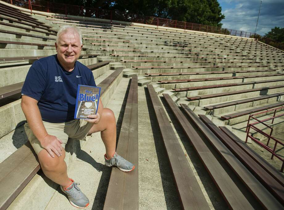 "Former Daily News sports editor Chris Stevens poses for a portrait with his new book, ""Hey, Blue!: My revealing journey as a softball umpire,"" on Wednesday, August 23, 2017 at Currie Stadium in Emerson Park. Photo: (Katy Kildee/kkildee@mdn.net)"