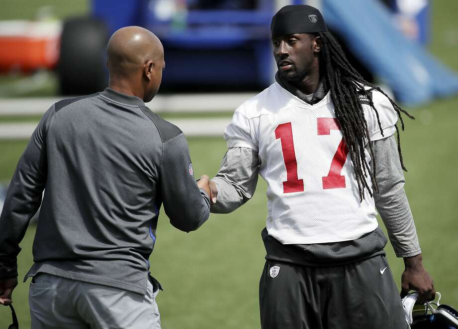 New York Giants wide receiver Dwayne Harris (17) talks to general manager Jerry Reese during NFL football practice, Wednesday, Aug. 23, 2017, in East Rutherford, N.J. (AP Photo/Julio Cortez) Photo: Julio Cortez, Associated Press