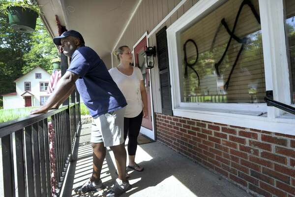 David and Senka Thompson found racial slurs spray painted on the front of their newly opened restaurant, Thompson's, at 300 Kent Rd. in New Milford Wednesday morning, August 23, 2017.