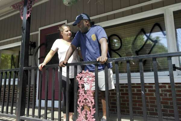 David and Senka Thompson, of Sherman, found racial slurs spray-painted on the front of their new restaurant, Thompson's, at 300 Kent Road in New Milford on Wednesday.