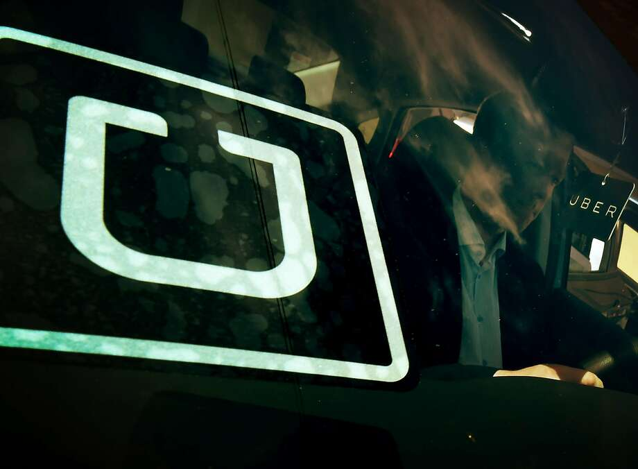 FILE-- For the second time this month, Judge Robert Lasnik rejected a challenge to Seattle's first-in-the-nation law allowing drivers of ride-hailing companies such as Uber and Lyft to unionize over pay and working conditions. Photo: MARK RALSTON, AFP/Getty Images