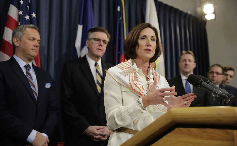 Texas Sen. Lois Kolkhorst, front, backed by Texas Lt. Gov. Dan Patrick, center, and other legislators talks to the media during a news conference to discuss Senate Bill 6 at the Texas Capitol in Austin, March 6, 2017. Just months after a high-profile study revealed that Texas has one of the highest maternal mortality rates in the developed world. Photo: Eric Gay /Associated Press / Copyright 2017 The Associated Press. All rights reserved.