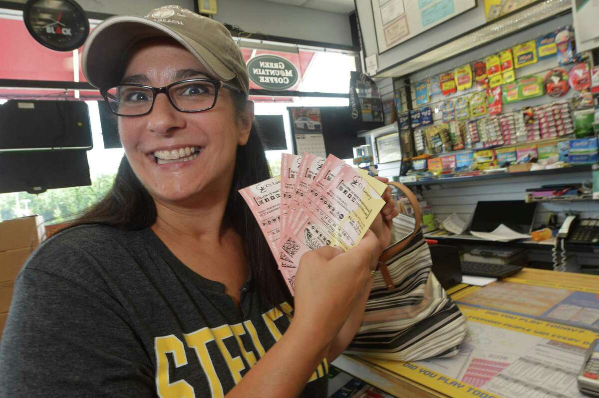 Norwalk resident Deb Ryan buys Powerball lottery tickets at Crossroads Variety at 280 Connecticut Avenue Wednesday, August 23, 2017, in Norwalk, Conn.