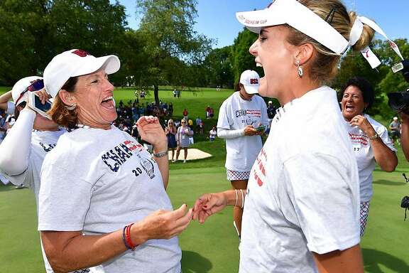 WEST DES MOINES, IA - AUGUST 20:  Juli Inkster, Captain of Team USA  celebrates with Lexi Thompson after the final day singles matches of The Solheim Cup at Des Moines Golf and Country Club on August 20, 2017 in West Des Moines, Iowa.  (Photo by Stuart Franklin/Getty Images)