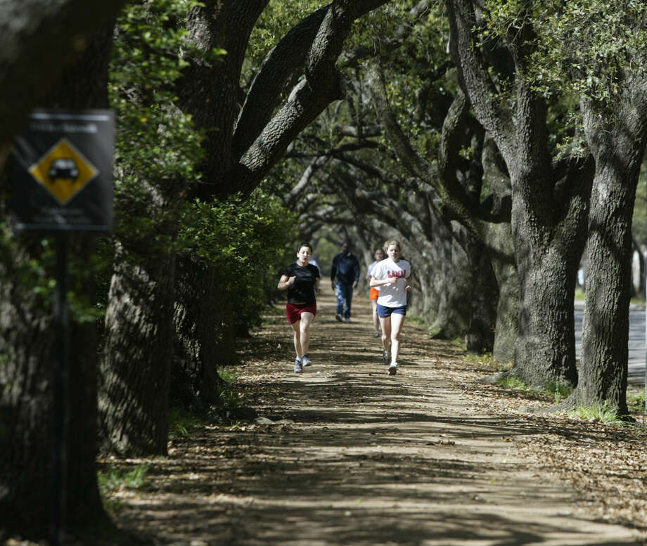 Joggers get a workout on the running path around Rice University.  Photo: Buster Dean, Staff Photographer / Houston Chronicle