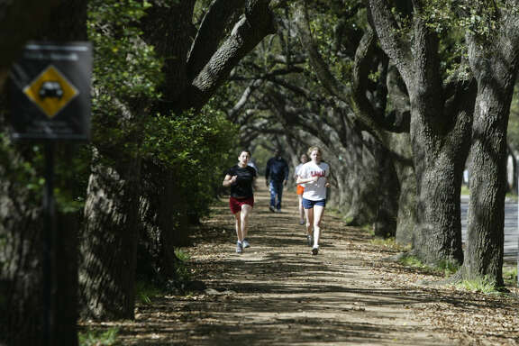 Joggers get a workout on the running path around Rice University.