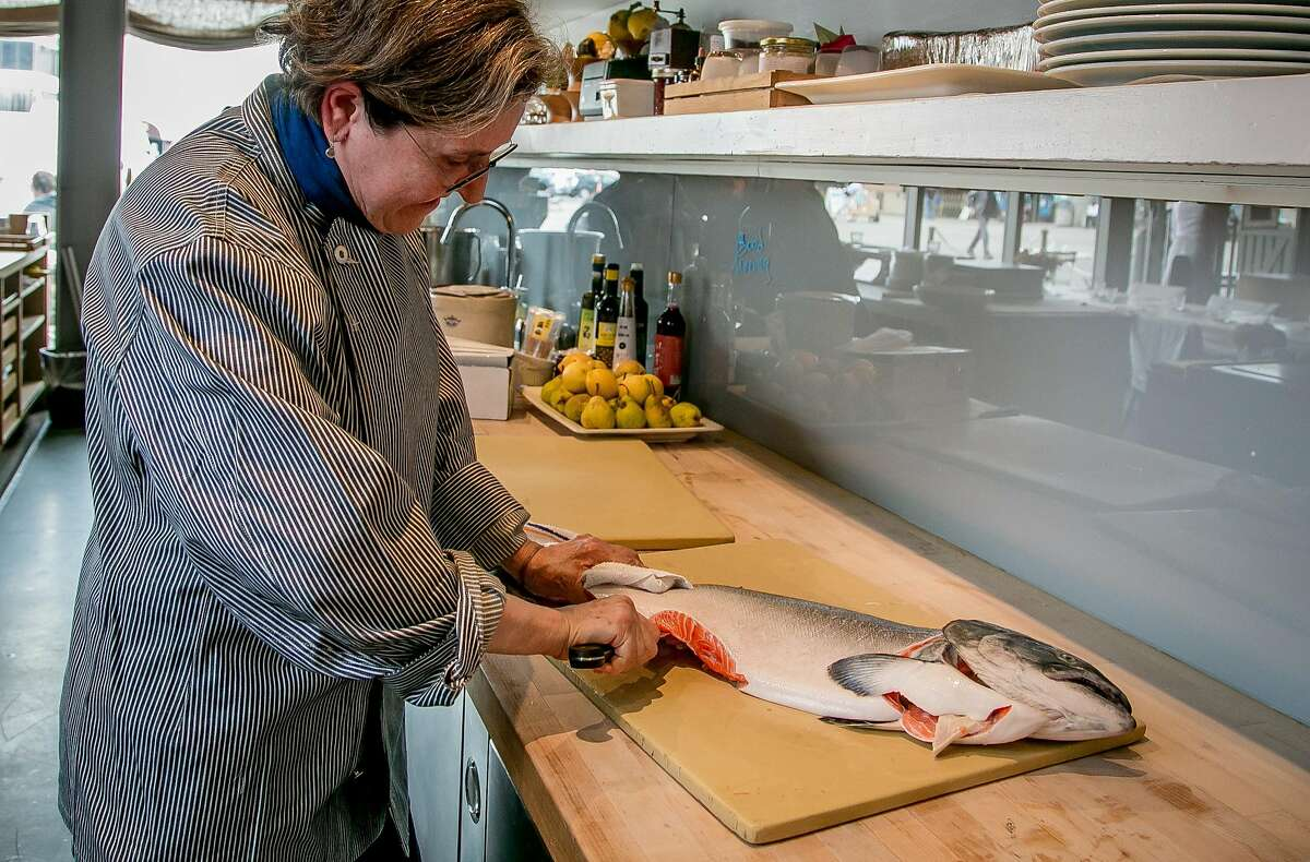 Chef Amaryll Schwertner breaks down a whole King Salmon at Bouli Bar in San Francisco, Calif. on August 23rd, 2017.