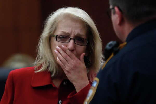 Sandra Melgar reacts after being convicted in the murder of her husband at the Criminal Courthouse, Wednesday, Aug. 23, 2017, in Houston.