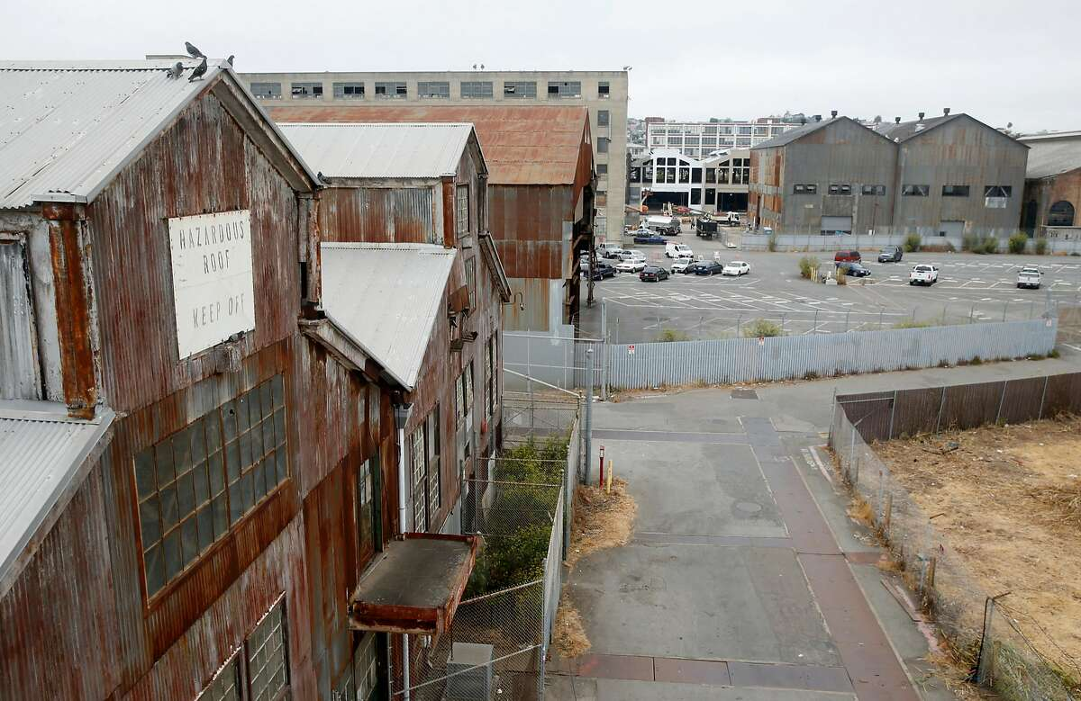 A pair of abandoned historic buildings are seen (left) at Pier 70 in San Francisco, Calif. on Wednesday, Aug. 23, 2017, which will be relocated several hundred feet if a proposed 28-acre redevelopment project by Forest City developers is approved.