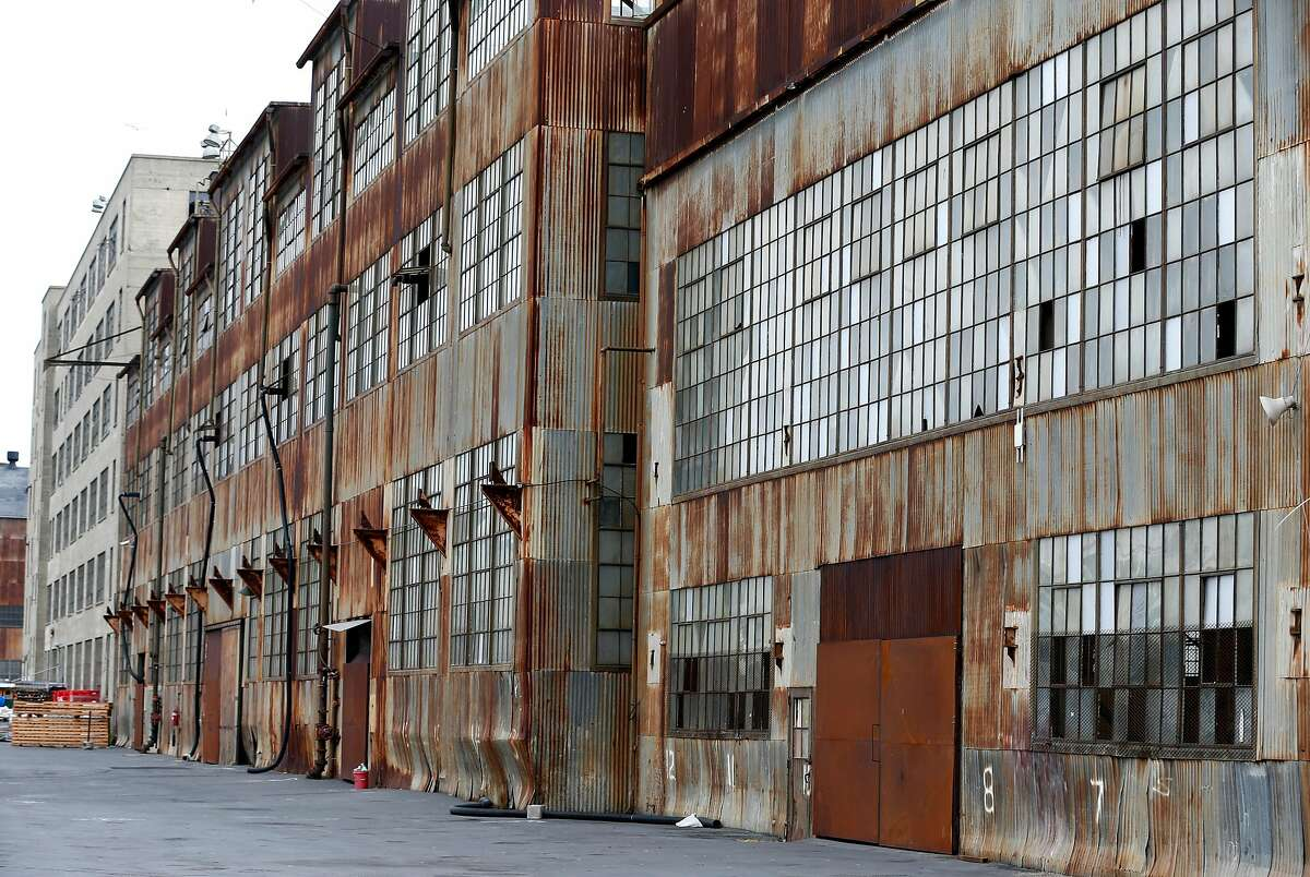 Panes of glass are broken or missing from an historic building at Pier 70 in San Francisco, Calif. on Wednesday, Aug. 23, 2017. Building 12, as it's referred to in a 28-acre mixed-use project proposed by Forest City developers, will be a main component of the redevelopment.