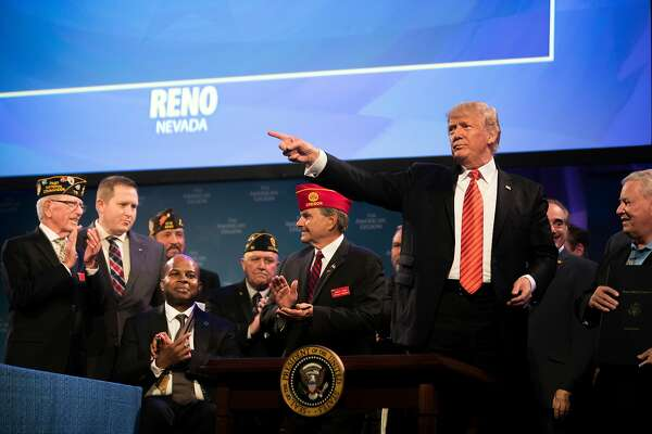 President Donald Trump after signing the Veterans Appeals Improvement and Modernization Act after making remarks to the National Convention of the American Legion in Reno, Nev., Aug. 23, 2017. (Tom Brenner/The New York Times)
