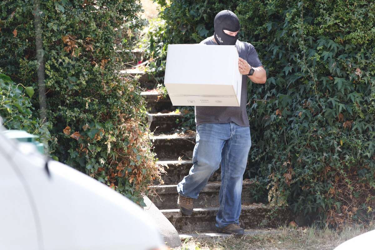 """Undercover Seattle detectives search for any remaining evidence at the Green Lake home of Charles, Edwin and Thomas Emery, three brothers in their 70s and 80s Thursday, August 23, 2017. Investigators say at least one of the brothers maintained """"an extensive 'collection' of materials related to the sexual assault and murder of female children."""""""