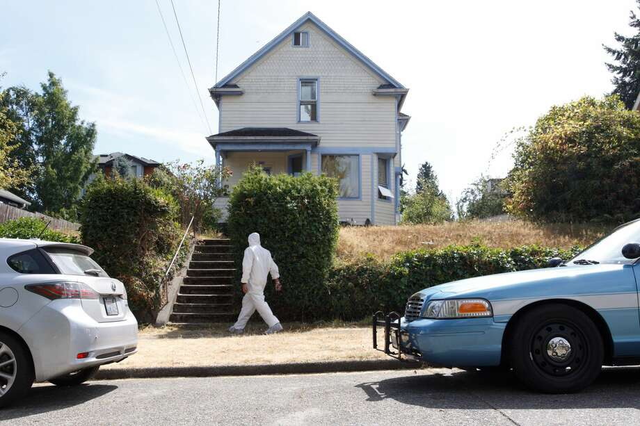 """Undercover Seattle detectives search for any remaining evidence at the Green Lake home of Charles, Edwin and Thomas Emery, three brothers in their 70s and 80s Thursday, August 23, 2017. Investigators say at least one of the brothers maintained """"an extensive 'collection' of materials related to the sexual assault and murder of female children."""" Photo: Grant Hindsley/SeattlePI.com"""