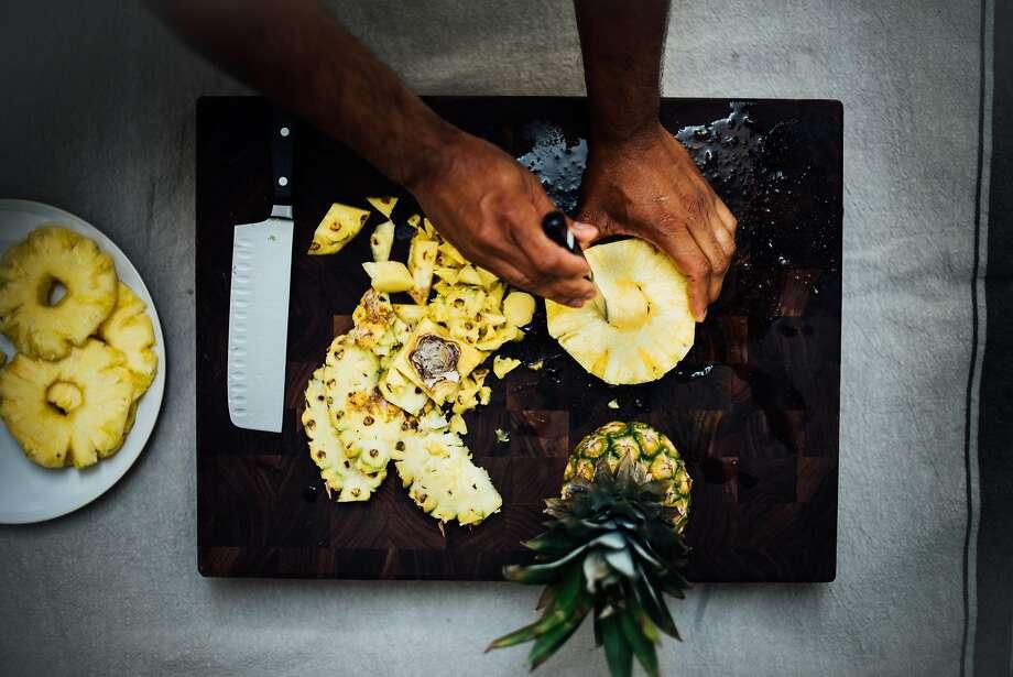Clean and chop pineapple for the raita. Photo: Nik Sharma
