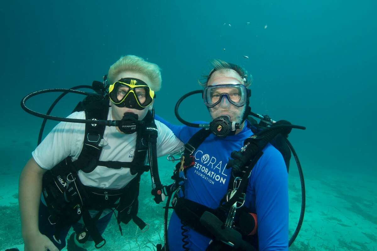 Henry with Ken Nedimyer, Key Largo, Florida Keys, Key Largo, August 2017. Aquarius Habitat and Coral Resoration Foundation coral nursery.