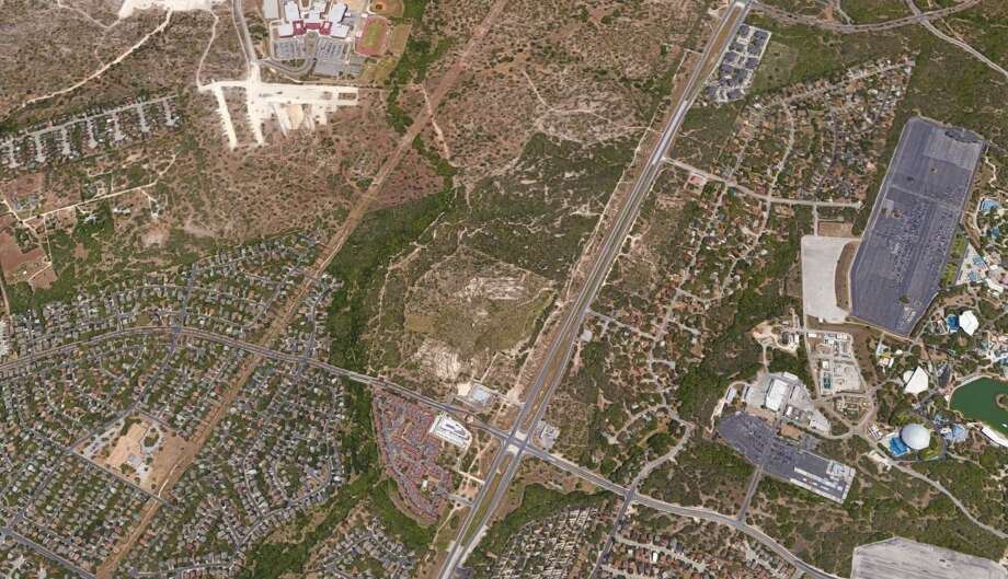 McCombs Enterprises wants to partner with other developers to build 60 acres of retail and three apartment complexes with about 350 units each on 145 acres of land near SeaWorld San Antonio. Photo: Google Maps