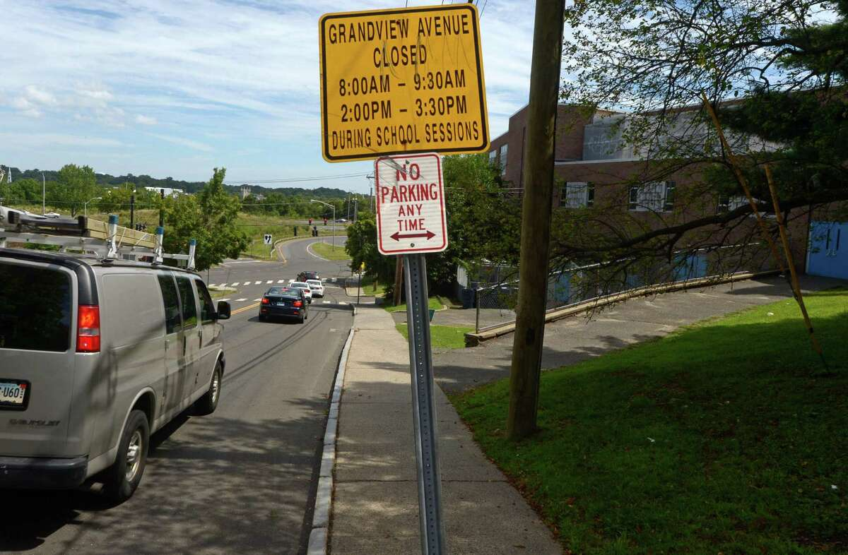 Signs on around Jefferson Science Magnet School on Grandview Avenue that state road closures around school arrival and dismissal times Wednesday, August 23, 2017, in Norwalk, Conn. After more than two decades of closing Grandview during arrival and dismissal hours at Jefferson School, the city?'s traffic engineers have come up with a new, safer plan which involve not closing the road will be implemented on the first day of school.