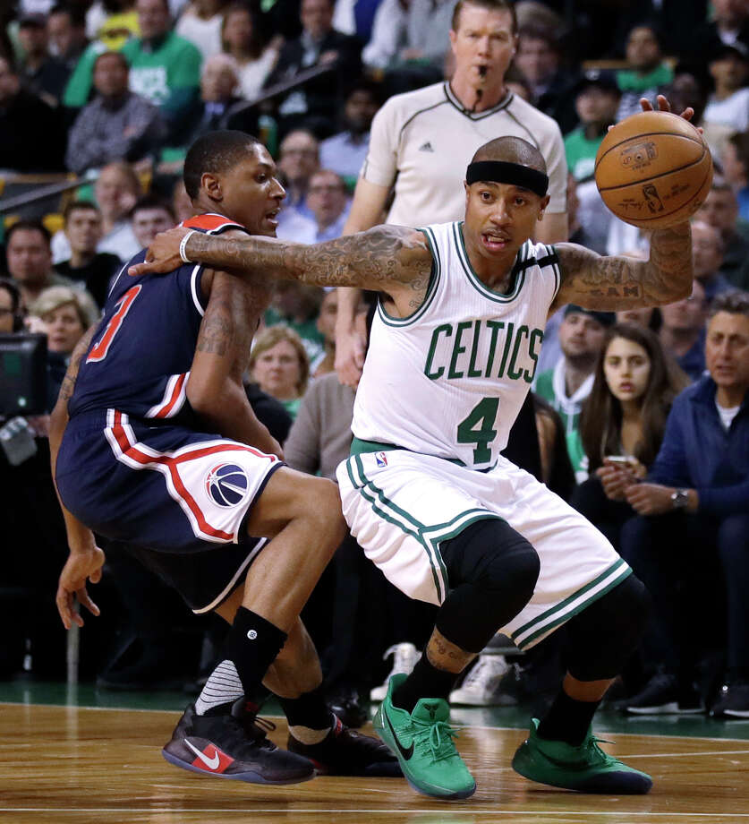 File-This may 10, 2017, file photo shows Boston Celtics guard Isaiah Thomas (4) driving to the basket during the first quarter of a second-round NBA playoff series basketball game in Boston.  Following the biggest slight of his NBA career, Thomas will have to prove his worth again. All eyes will be watching how he rebounds after Tuesday's blockbuster trade. The Celtics sent the two-time All-Star packing from a franchise and city that he'd embraced with every ounce of his 5-foot-9 frame. He's now bound for Cleveland in exchange for what the Celtics believe is a bigger star, and better point guard, in Kyrie Irving. (AP Photo/Charles Krupa, File) Photo: Charles Krupa, STF / Copyright 2017 The Associated Press. All rights reserved.