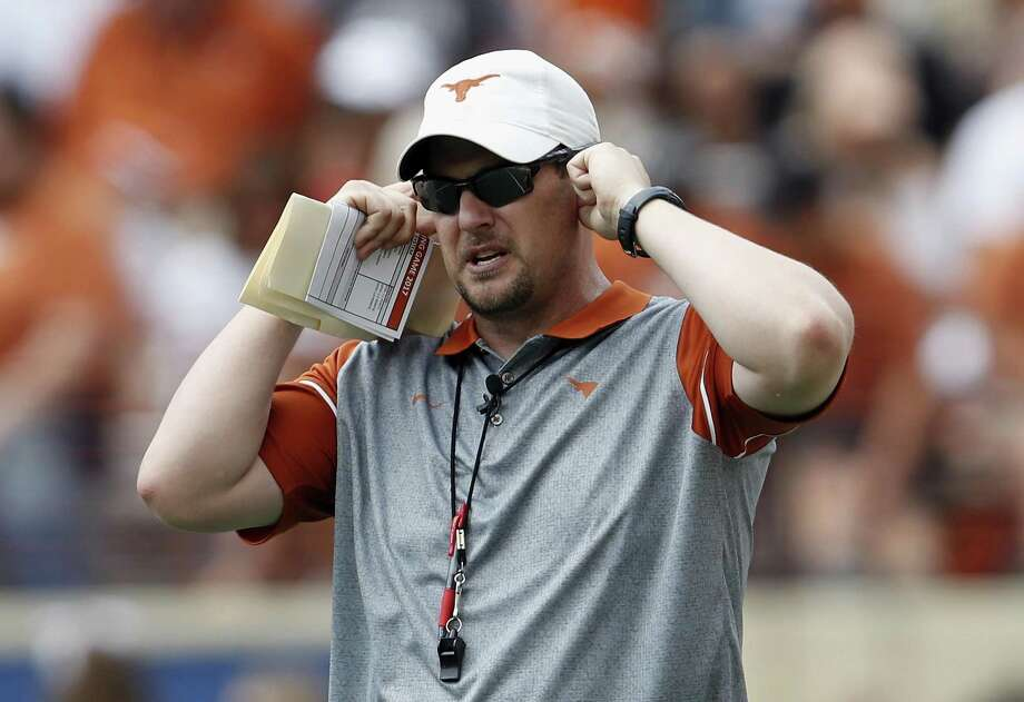 Head coach Tom Herman of the Texas Longhorns listens to a play call during the spring game on April 15, 2017 in Austin. Photo: Tim Warner /Getty Images / 2017 Tim Warner