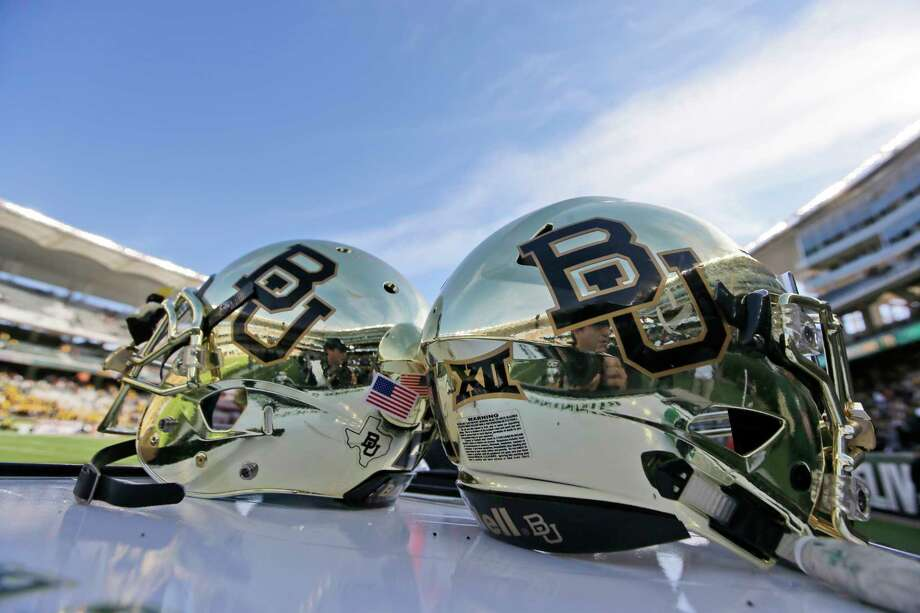 FILE - In this Dec. 5, 2015, file photo, Baylor helmets on shown the field after an NCAA college football game in Waco, Texas. For more than a year, the federal civil lawsuits against Baylor have piled in and piled on, accusing the nation's largest Baptist school of mishandling, ignoring or stifling claims of sexual and physical abuse of students for years. After months of bad publicity, the firing of a popular football coach and demotion and departure of a school president, Baylor is starting to make those cases go away with settlements as evidence gathering is just heating up and well before any of them approach trial. (AP Photo/LM Otero, File) Photo: LM Otero, STF / Copyright 2017 The Associated Press. All rights reserved.