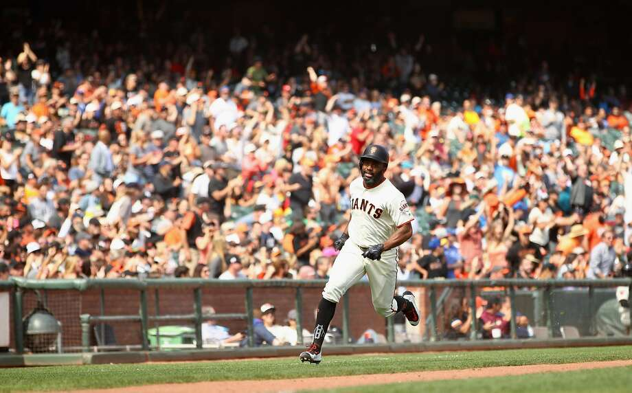 Denard Span sprints around third on his way home on Jarrett Parker's check-swing, two-run double in the seventh inning. The hit broke a 1-1 tie and sparked the Giants to a win. Photo: Ezra Shaw, Getty Images