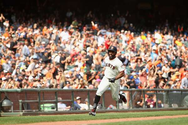 SAN FRANCISCO, CA - AUGUST 23:  Denard Span #2 of the San Francisco Giants runs home to score on a hit by Jarrett Parker #6 in the seventh inning of their game against the Milwaukee Brewers at AT&T Park on August 23, 2017 in San Francisco, California.  (Photo by Ezra Shaw/Getty Images)