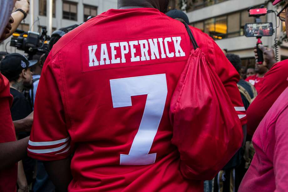 A rally in support of Colin Kaepernick, the former NFL quarterback, outside the leagueÕs headquarters on Park Avenue in Manhattan, Aug. 23, 2017. KaepernickÕs protests of police brutality and racial oppression have made him one of the most talked-about players of the upcoming football season, even without a team. (Hiroko Masuike/The New York Times) Photo: HIROKO MASUIKE, NYT